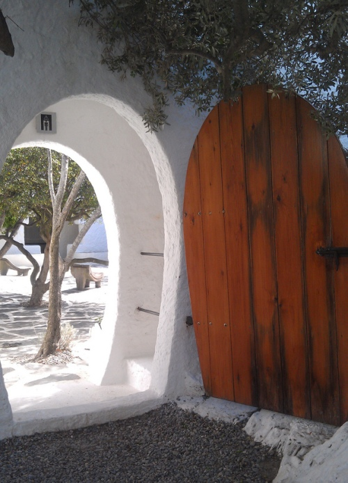 "One of Dali's egg-doors to his garden patio,,we""ll be out back having some cava. Back with you in a while. Photo by Heather Granahan"