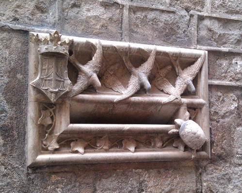 Pretty...mysterious.A lovely old frieze, off by a lonely back door behind a cathedral. Photo by Heather Granahan