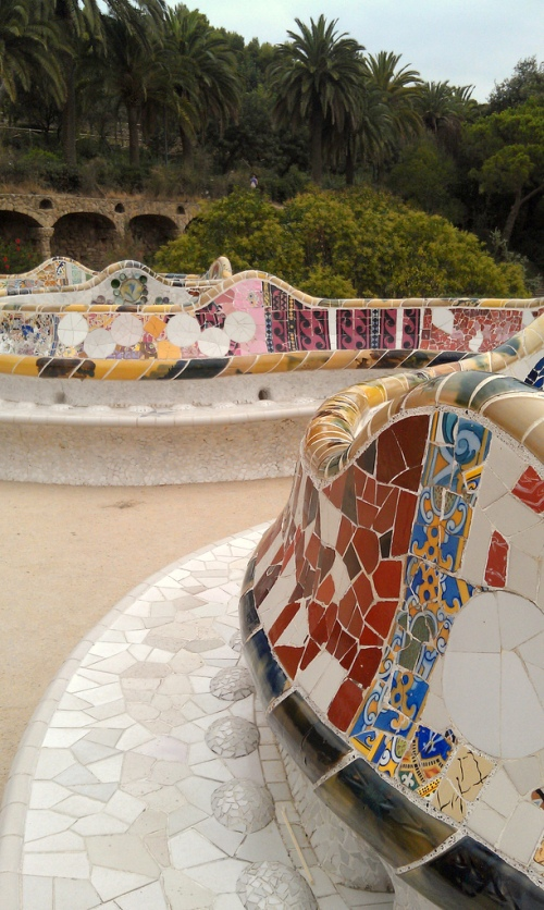 A wall that invites you to sit on it. Gaudi built Park Guell for Barc in 1900-14 and made good use of local tiles. The wall snakes around a bluff that looks out over the city of ancient, modern, and stuff like Gaudi's; 100 yrs old and still fresh. Photo by Heather Granahan