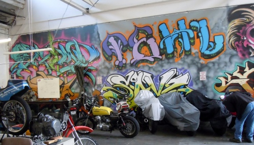 Here are a few clients bikes stored against the wall of art – a privilege available with a monthly repair station reservation.